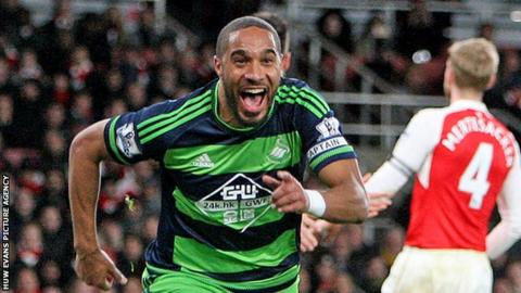 Ashley Williams celebrates scoring against Arsenal