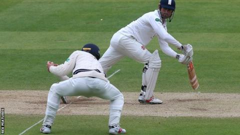 Alastair Cook is caught by Stevie Eskinazi at short leg