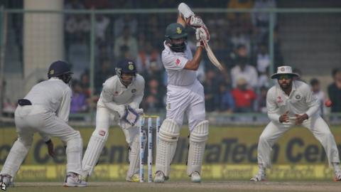 South Africa captain Hashim Amla defies the India bowlers