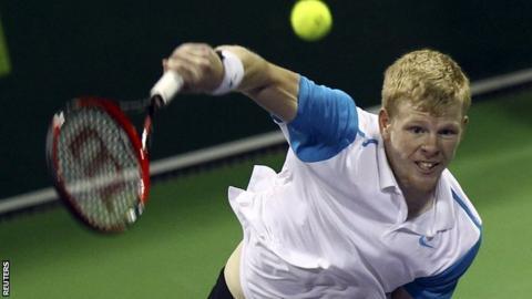 Kyle Edmund hits a serve