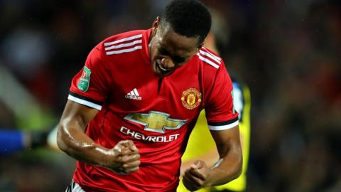 Manchester United's Anthony Martial celebrates scoring his side's fourth goal