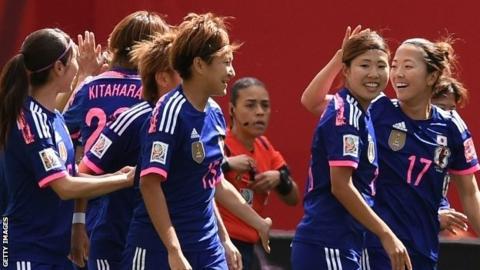 Japan celebrate their opening goal