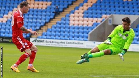 Joe Mason (L) of Cardiff City and Shrewsbury Town goalkeeper Jayson Leutwiler