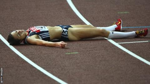 An exhausted Jo Pavey lies on the track in Osaka