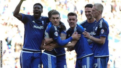 Stuart O'Keefe celebrates with his Cardiff team-mates after his winner against Derby