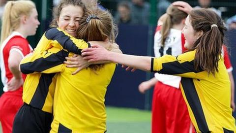 girls hug after a game of football at the FA People's Cup
