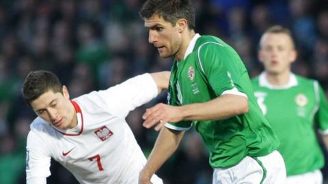 Poland's Robert Lewandowski battles with Northern Ireland's Aaron Hughes during the World Cup qualifier at Windsor Park in March 2009