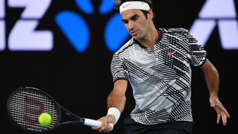 Roger Federer plays a forehand shot