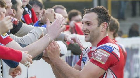 Tommy Lee celebrates with the Salford fans