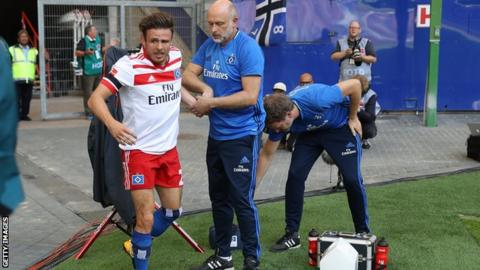 Hamburg winger Nicolai Muller ruptures knee ligaments in botched goal celebration