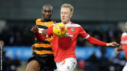 Newport's Scott Boden in action against Barnet