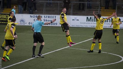 Derek Riordan leaps in celebration after his 76th minute equaliser for City against the league leaders