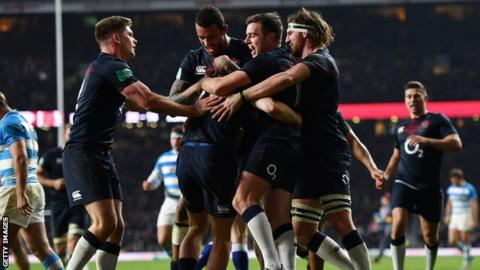 England celebrate scoring a try against Argentina