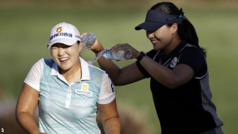 Lee Mi-Rim (left) has water poured on her by fellow South Korean Chun In-gee after her victory