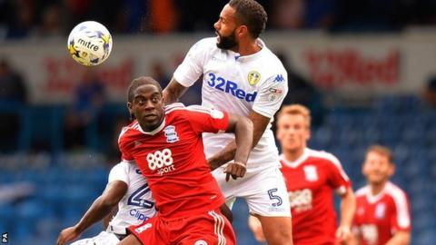 Birmingham City striker Clayton Donaldson is challenged by Leeds United duo Kyle Bartley and Ronaldo Vieira at Elland Road