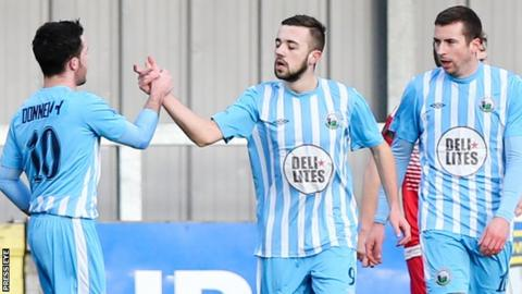Warrenpoint players celebrate one of the five goals they scored against Crewe on 4 February
