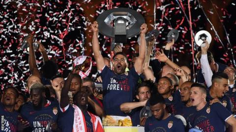 Radamel Falcao celebrates with the trophy and team mates after winning Ligue 1