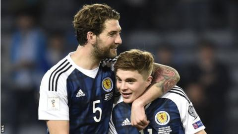 Charlie Mulgrew celebrates Scotland's win over Slovenia with James Forrest