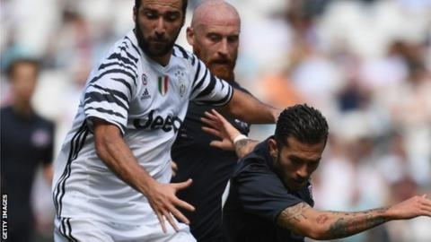 Lewis Page tangles with Gonzalo Higuain in West Ham United's pre-season friendly against Juventus