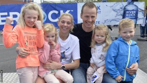 Laura Graham with husband Thomas and children Leila, Darcy, Payton and Jaden after her Belfast Marathon triumph