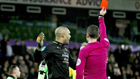 Carl Ikeme was shown his red card at Carrow Road by match referee David Coote