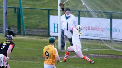 Antrim midfielder Paul Shiels watches his shot hit the top corner for the opening goal at Owenbeg