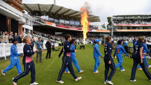 England and India players walk out at Lord's