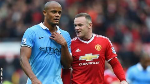Manchester City's Vincent Kompany and Manchester United's Wayne Rooney