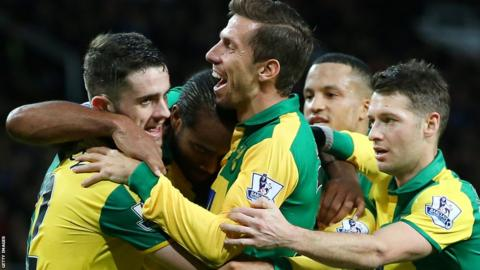 Norwich players celebrate against Manchester United