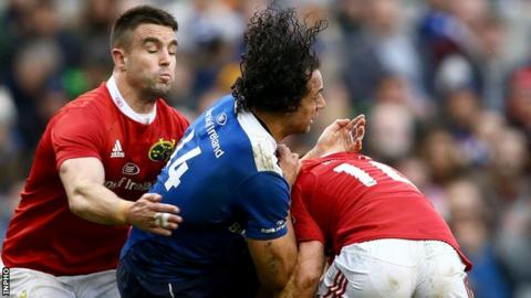 Munster's Ireland pair Conor Murray and Keith Earls tackle Leinster's Isa Nacewa