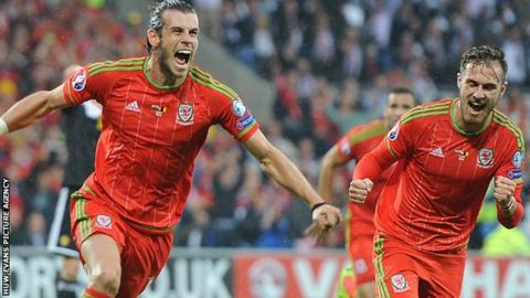 Gareth Bale and Aaron Ramsey celebrate Wales' goal against Belgium in Cardiff
