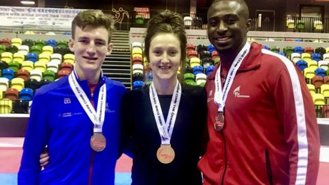 Lauren Williams, Bradly Sinden and Mahama Cho pose with their medals at the World Taekwondo Grand Prix