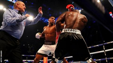 Anthony Joshua stops Carlos Takam in round 10 to defend IBF and WBA titles