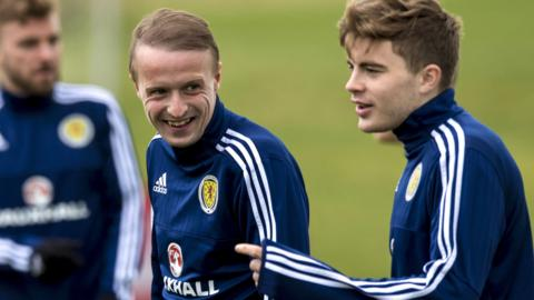 Celtic duo Leigh Griffiths and James Forrest share a joke at Scotland training