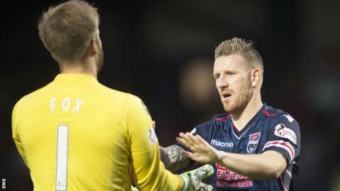 Ross County goalkeeper Scott Fox congratulates Michael Gardyne