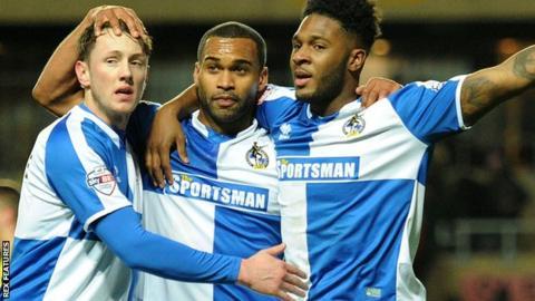 Bristol Rovers celebrate after Ellis Harrison's winning penalty