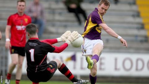 Down keeper Stephen Kane keeps out Kevin O'Grady's shot