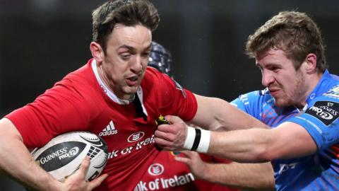 Munster's Darren Sweetnam is tackled by Scarlets centre Steff Hughes