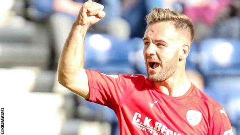 Adam Armstrong celebrates his goal for Barnsley