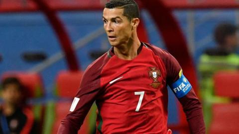 Cristiano Ronaldo controls the ball