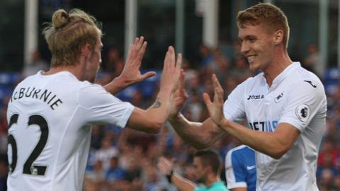 Oliver McBurnie (left) celebrates with Jay Fulton