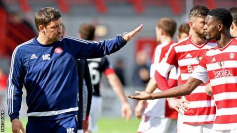 Martin Canning celebrates with opening goalscorer Rakish Bingham