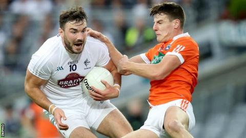 Armagh's Niall Grimley challenges Kildare's Fergal Conway