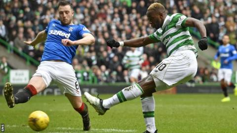 Danny Wilson tries to block Moussa Dembele