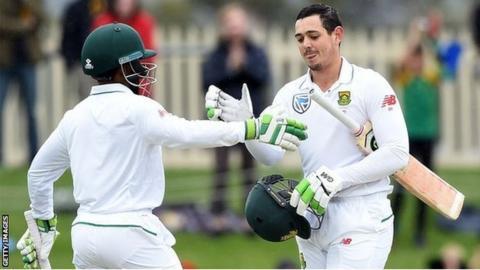 Temba Bavuma congratulates Quinton de Kock on his century