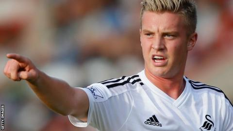 Adam King in action for Swansea City in pre-season