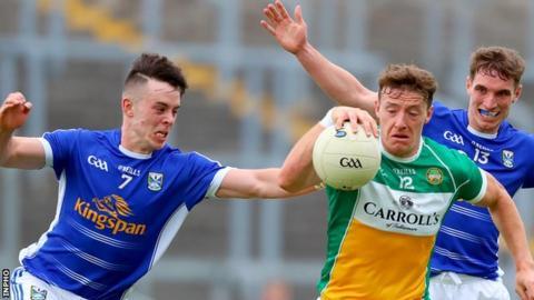 Cavan defender Dara McVeety challenges Offaly's Michael Brazil at O'Connor Park