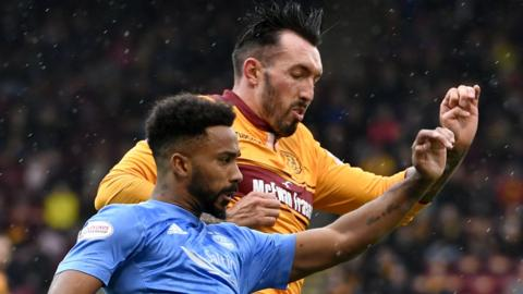 Aberdeen's Shay Logan and Motherwell's Ryan Bowman