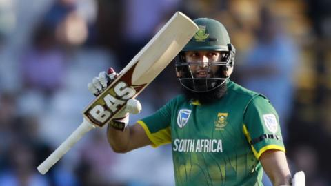 Hamish Amla celebrates bringing up his half-century