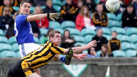 Naomh Conaill's Brendan McDyer gets his shot away as Caolan Brown attempts a block in the Donegal final